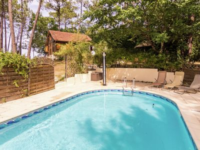 Photo for Chalet located In a wooded area with private pool.