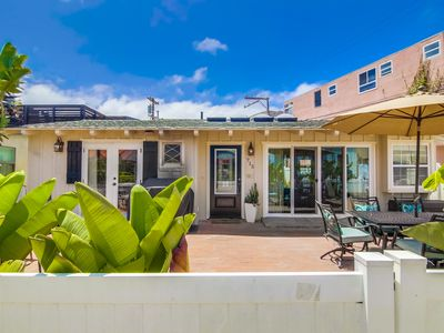 Photo for Oceanfront House with big patio right on the Beach!