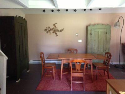 Country chic. Dining/living area is large and inviting.   Table expands for 6.