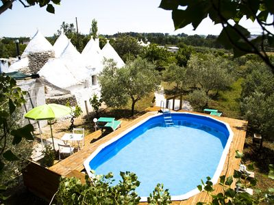 Photo for Authentic Trulli with swimming pool in Itria Valley Apulia