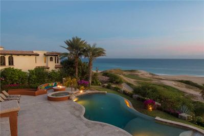 Enjoy lounging by the pool and watching the sunset