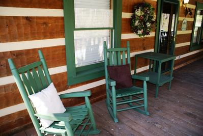 Two wood rockers are waiting for you on the front porch. Sit and Relax a while