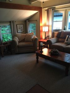 Living room is spacious, LCD TV w/ DVD player, movie collection, Wi-Fi provided