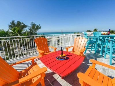 Photo for CALL NOW FOR PRICING! STUNNING ROOFTOP DECK WITH LOTS OF SEATING & GULF WATER VIEWS! 30 SECOND WALK TO THE BEACH!