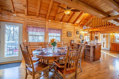 Large dining area and breakfast bar off fully equipped kitchen.
