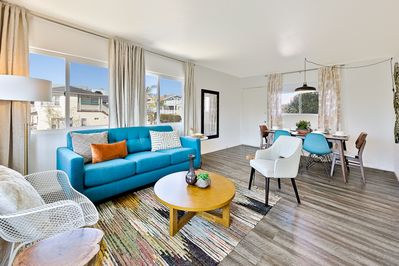 """Turquoise accents create a beach chic energy that welcomes you """"back home"""" after your  or night-time adventures."""