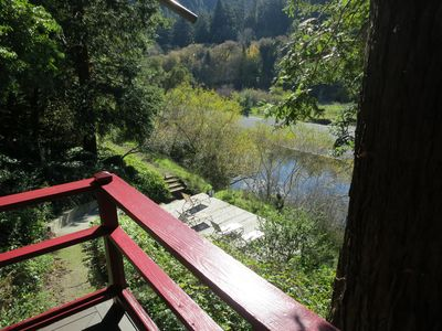 View from deck off living room, overlooking the lower deck and the river