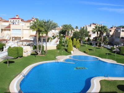 Photo for Spacious 3 Bedroom Apartment with Communal Pool and Air con in Playa Flamenca