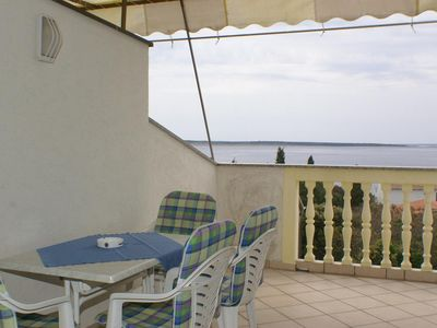 Photo for One bedroom apartment with terrace and sea view Mandre, Pag (A-4098-b)