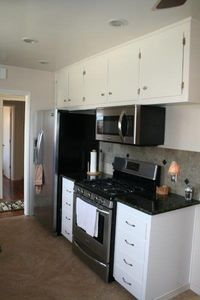 functional kitchen with new appliances