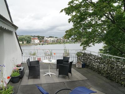 Photo for Romantic apartment and terrace overlooking the reservoir Essen Kettwig
