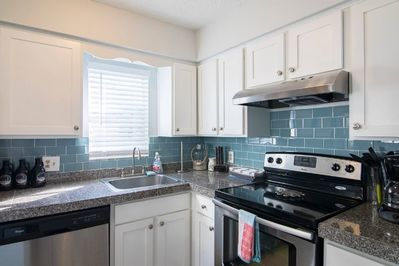 Full Kitchen with blue glass backsplash