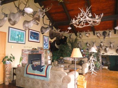 Whitebird Summit Lodge great room sitting area with fireplace and large deck