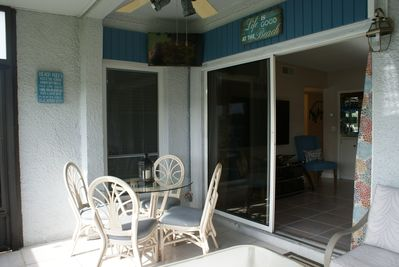 Breakfast area with TV in the lanai;  drink your morning coffee, watch the boats