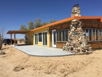 Front of cabin with patio and cover