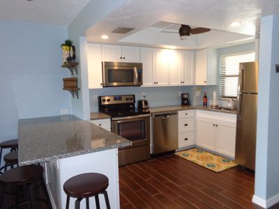 Photo for Updated condo & renourished soft white sandy beach, walk to St. Armand's Circl