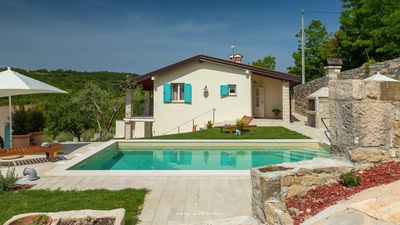 Photo for Cosy villa with private pool surrounded by green