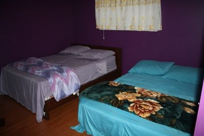 Master Bedroom re-arrange to fit 2 queen size bed and airbed