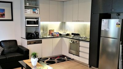 Full stocked Kitchen with cooking utensils and cleaning products. Dishwasher