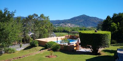 Photo for Charming Rustic Lodge with Pool and Lovely views. Walk to Tapas Bar and Beach.