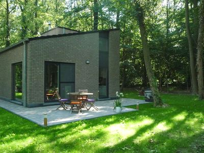 Photo for Modern holiday home in forested area with spacious garden, terrace and WiFi