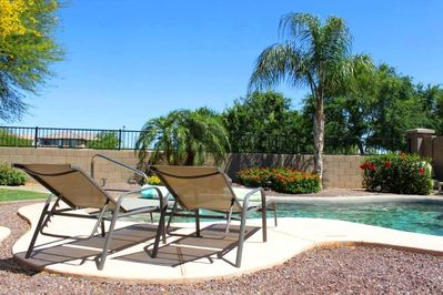 Paradise! Relax by your private pool backing onto a green space.