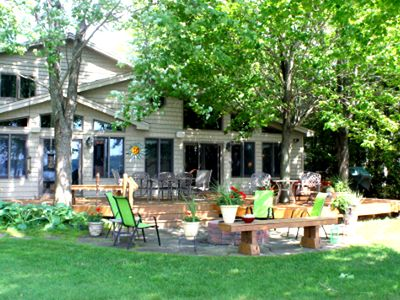 Photo for Million Dollar Home with a large fireplace, hot tub and sauna! In Traverse City