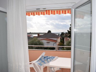 Photo for Two bedroom apartment with terrace and sea view Novalja, Pag (A-6491-b)