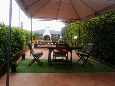Photo for Holiday home with lovely garden surrounded by greenery just a few km from Lucca