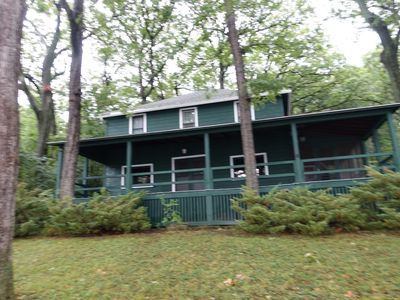 Photo for Private lakefront cottage on wooded lot