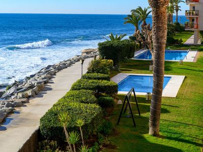 Photo for 4 bedroom Apartment, sleeps 10 with Pool and Walk to Beach & Shops