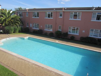 Photo for Special offer. Lovely apartment with heated outdoor pool 2 mins from sandy beach