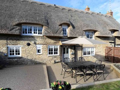 Photo for Beautiful thatched grade two listed cottage