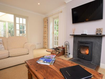 Cuddle up in front of the cosy log burner in the winter months
