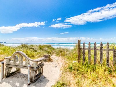 Photo for Dog-friendly oceanside escape with easy beach access and peaceful surroundings