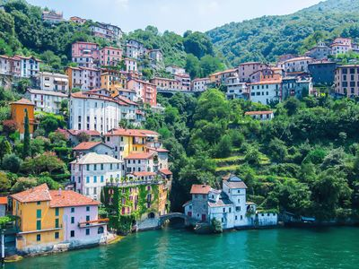 Photo for Apartment with scenic views on blue waters of Lake Como and its green mountains.