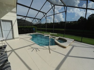 Photo for 4 Bedroom, Overlooking Lake, Pool & Spa in Gated Community Close to Disney
