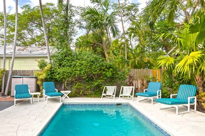 Pool features lush tropical surroundings for extra privacy.