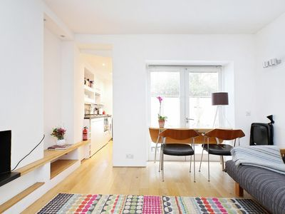 Photo for Bright One Bedroom with Garden Patio & Direct Access to Private Estate Gardens (W11) CLAR