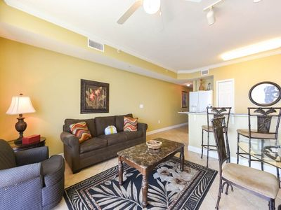 Photo for Welcoming beach-front condo! Free beach service! Two lagoon pools + movie center on-site!