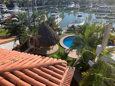 Photo for Beautiful marina house with private pool and rooftop + jacuzzi