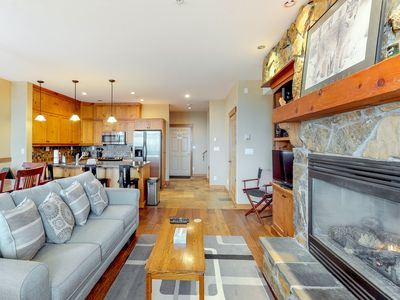 Photo for NEW LISTING! Ski-in/out village center condo w/ private hot tub & mountain views