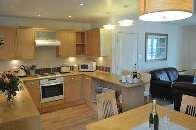 Open plan, fully fitted kitchen.