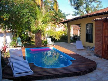 House season in Cabo Frio, RJ - 1 suite + 3 bedrooms C / C Pool / Air Cond.