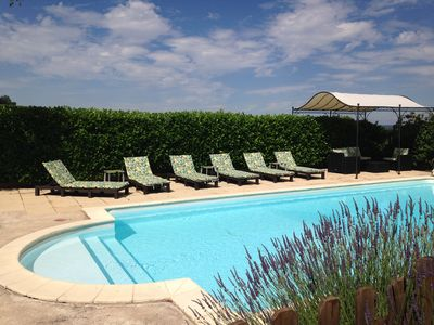 Heated pool with roman steps and shaded seating