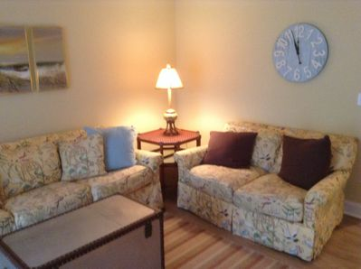 Den area with couch and loveseat