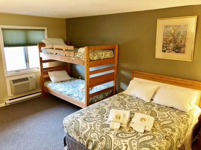 View of twin bunk beds and queen bed. Sleeps 4 comfortably.