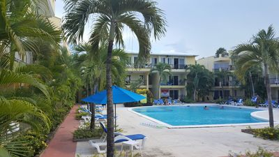 Photo for Central, quiet, condo, guest friendly, large swimming pool, lush tropical garden