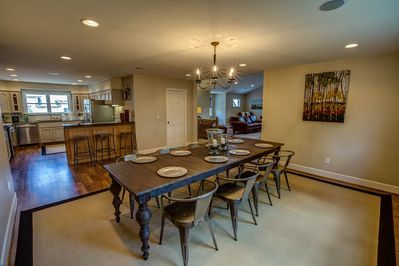 Dining room, table extends to 12 feet, room seats 18 with bench and barstools