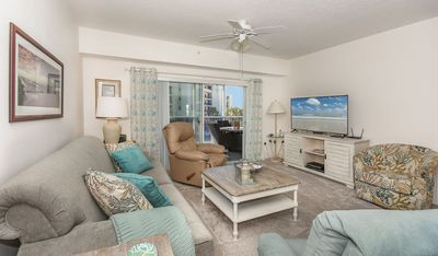 Photo for Get close to the beach in this beautiful coastal themed 2 bed 2 bath condo. OW1-303